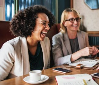 stock photo free use women laughing during business meeting at work